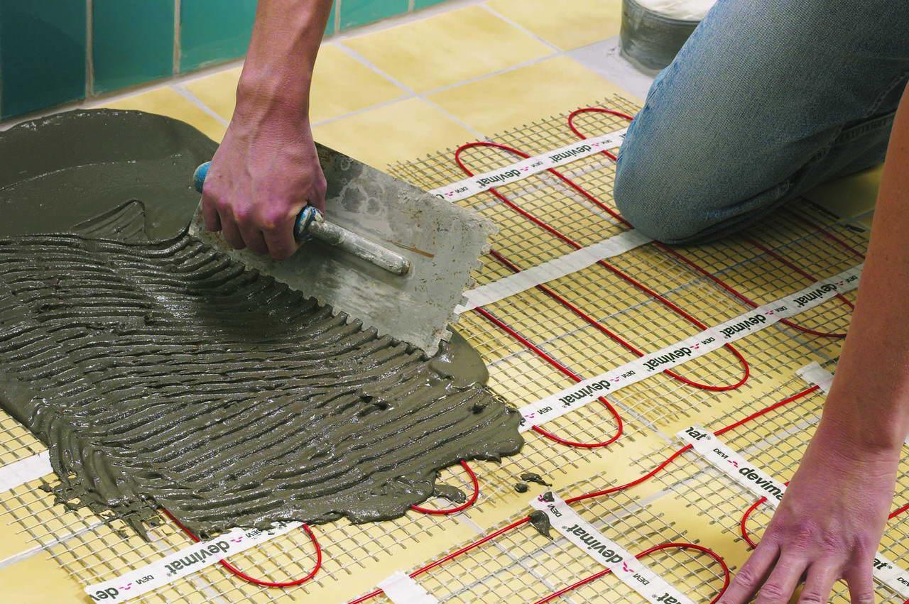 Чем залить теплый пол под плитку своими руками